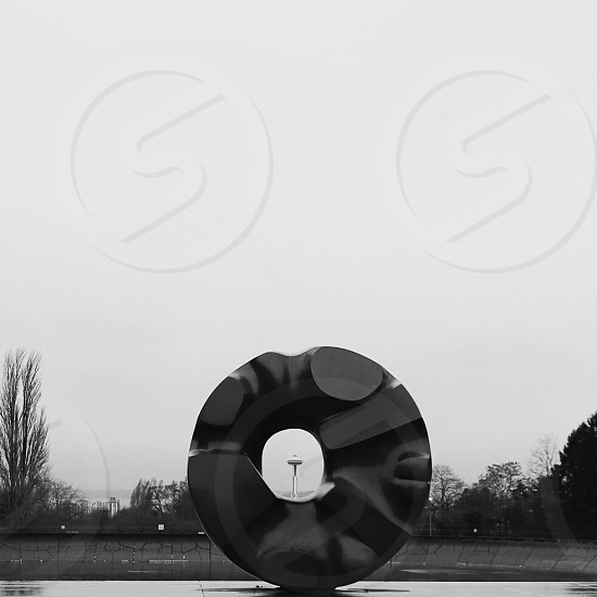 large round abstract sculpture with hole in the middle  photo