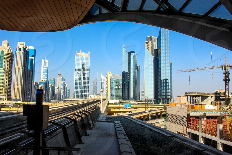 The view from the Metro in Dubai. The cityscape of a desert world.  photo