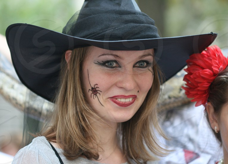 woman with brown short hair wearing costume of witch photo