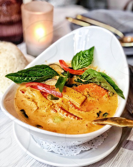 Thai red curry with fresh basil photo