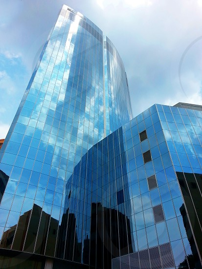 worm's eye view of glass paneled building photo