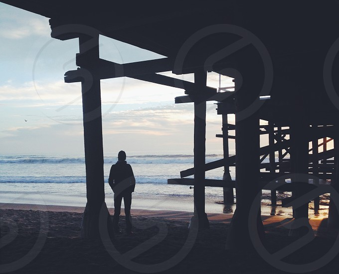 man's silhouette and sea photography photo