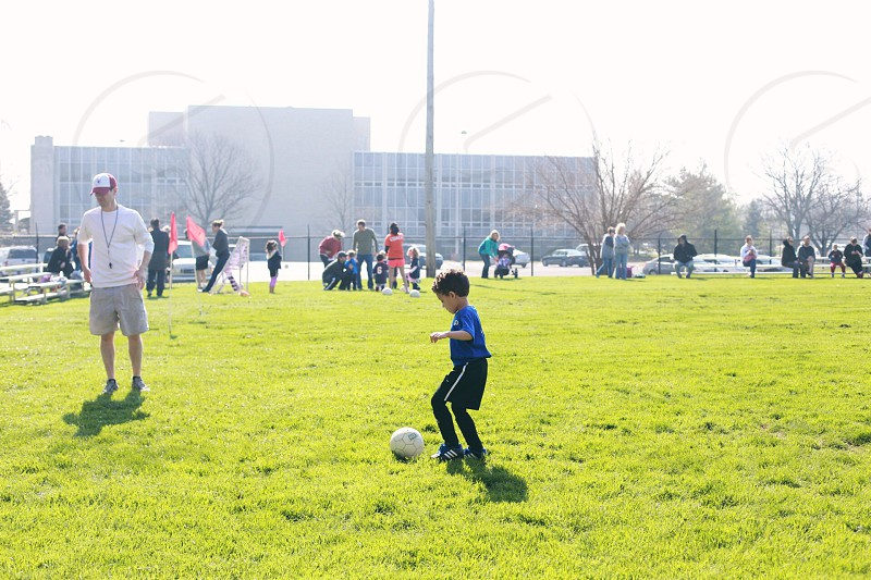 boy playing soccer photo