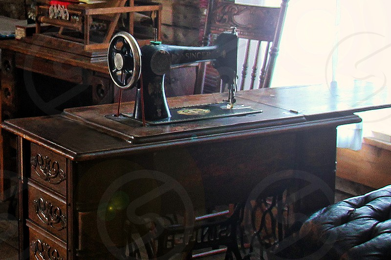 Vintage sewing machine and sewing room photo
