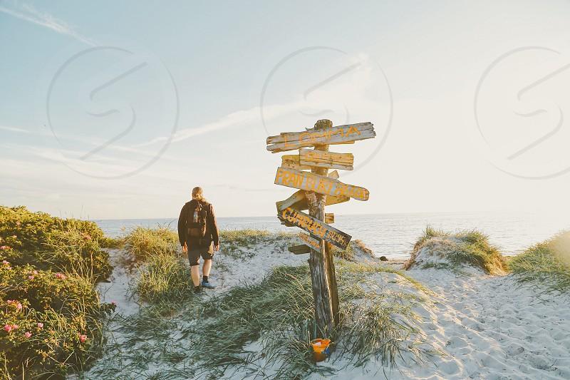 Backpacker backpack horizon sea ocean water endless eternity sandy beach beach  direction man  photo