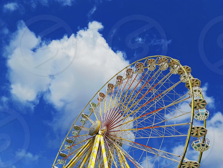 Close up view of the Roue de Paris the big ferris wheel above a deep blue sky background located in the Jardin des Tuileries in Paris France. photo
