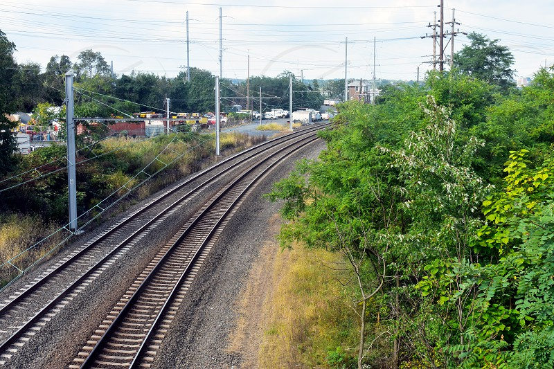 Steel rail road tracks over crushed stones  disappearing in the distance (5) photo