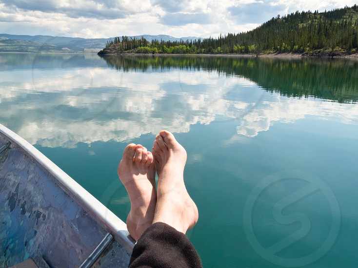 Relaxing in motorboat drifting on calm Lake Laberge Yukon Territory Canada photo