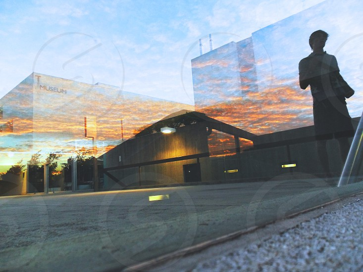 The Queensland Museum reflected in a glass wall trough a beautiful sunset. Brisbane Australia. photo