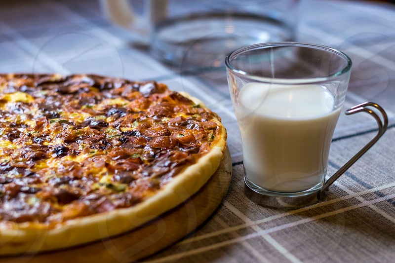 Homemade quiche (tart) with pickles ham prosciutto and cheese photo