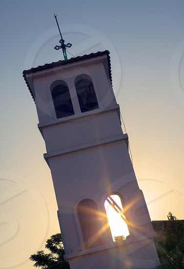 Orthodox church in Greece morning scene with sun ray through window.  photo