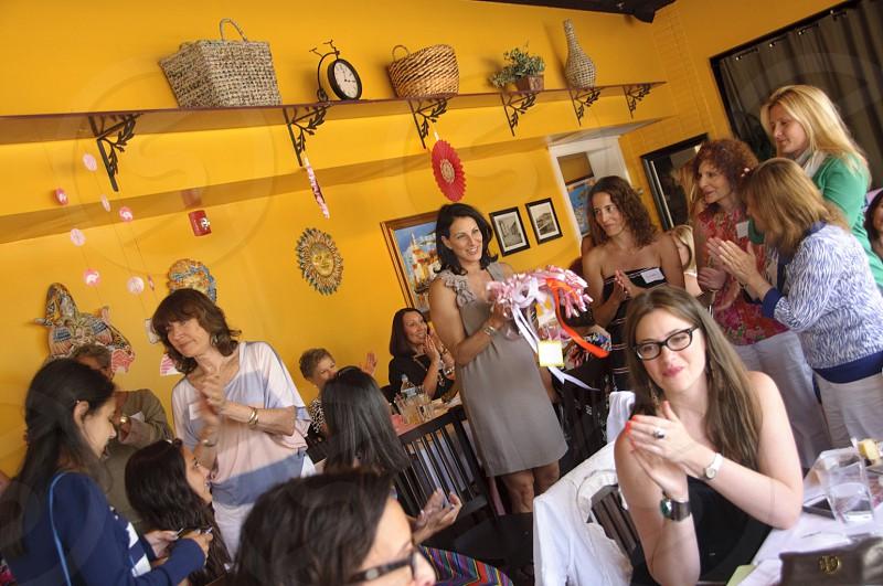 women gathered inside room photo