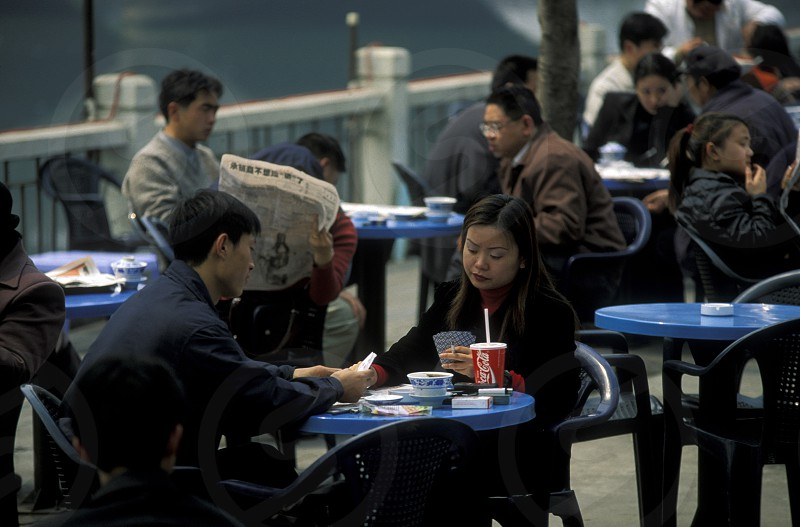 Chinese People siting in Tea House in the city of Chengdu in the provinz Sichuan in centrall China. photo