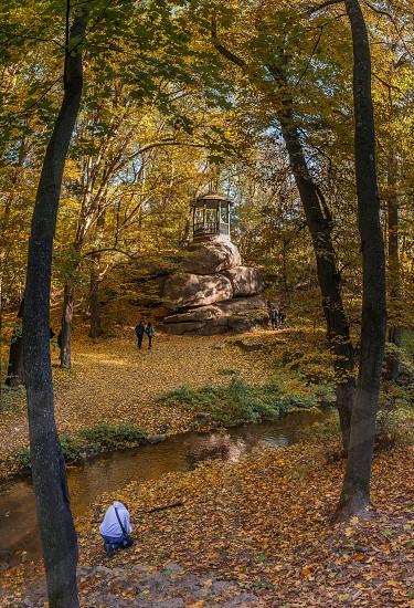 Uman Ukraine - 10.13.2018. Beautiful autumn trees around the old alcove in Sofiyivka park Ukraine photo