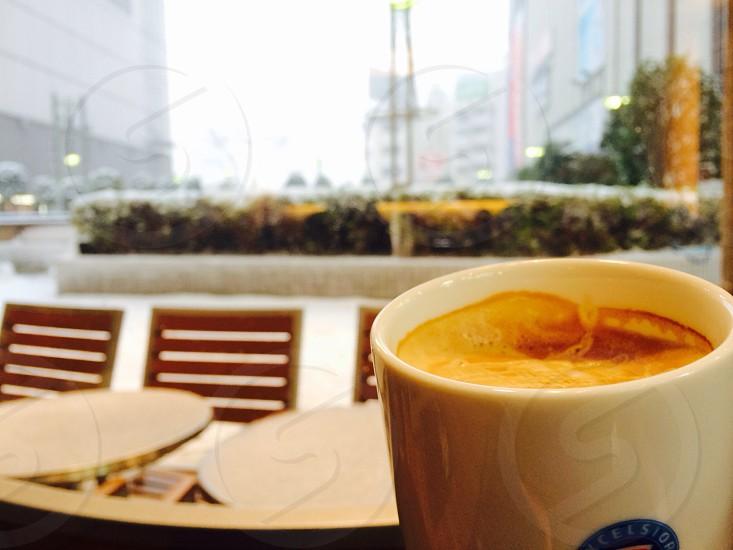 white mug with coffee photograph  photo