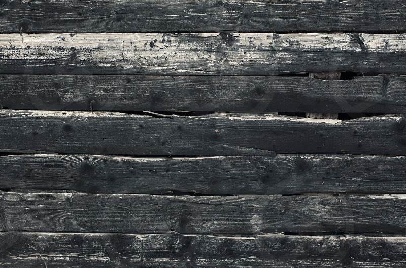 Details of a texture of an old dark wooden wall.  photo