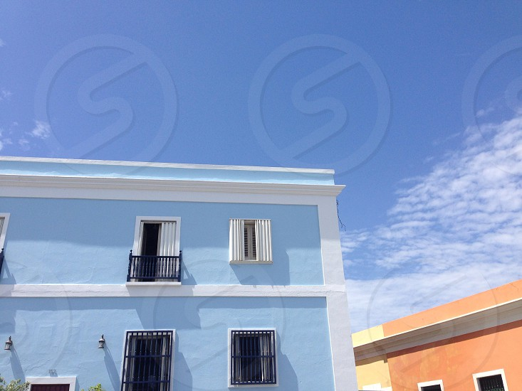 blue and white multi level tenement building photo