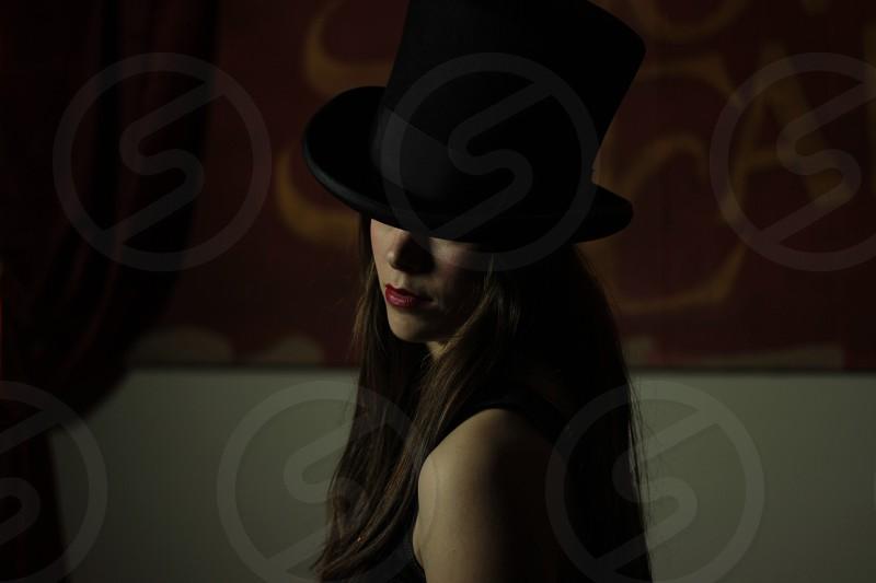 woman wearing black hardtop hat photo
