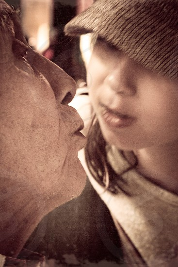 Girl kissing Grandfather  photo