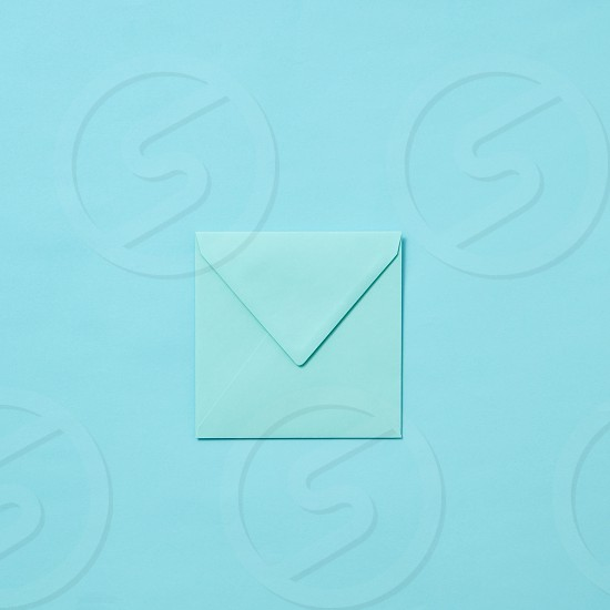 Mock up handmade envelope for greeting card or love letter on a pastel blue background with copy space. Top view. photo
