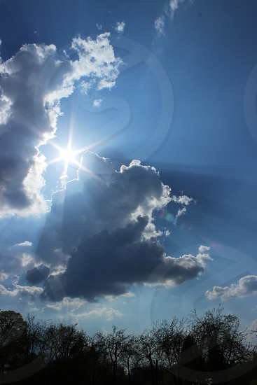 blue and white clouds  with sun  photo