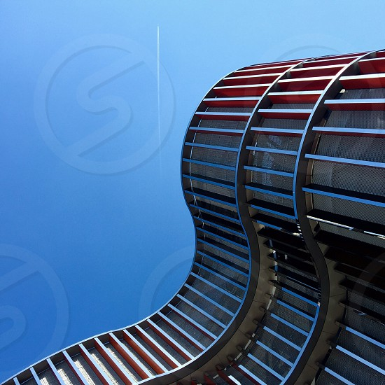 spiral glass building during daytime photo