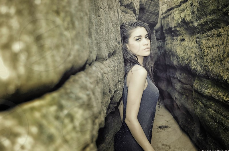 Against a rock photo