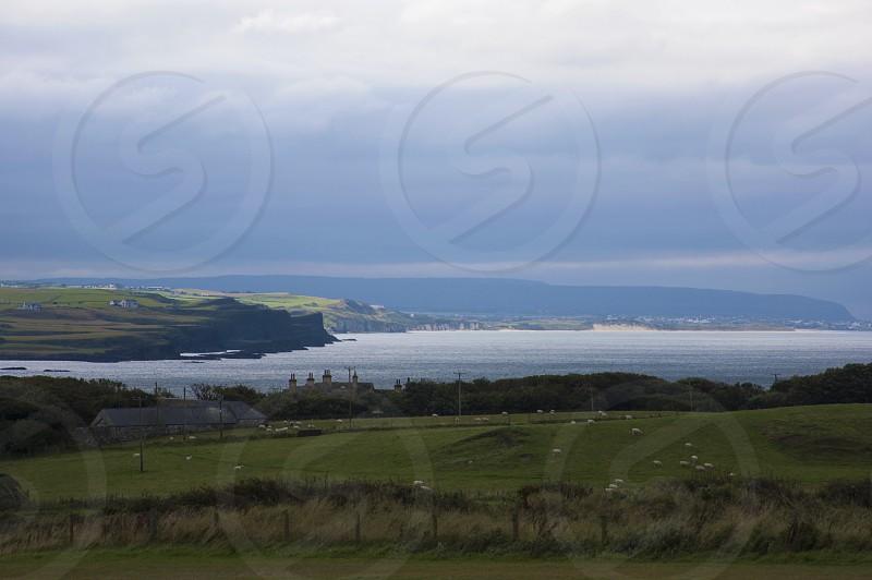 Antrim Coast Road Northern Ireland Irish Sea Autumn Rolling countryside Rocks Cliffs Moody weather photo