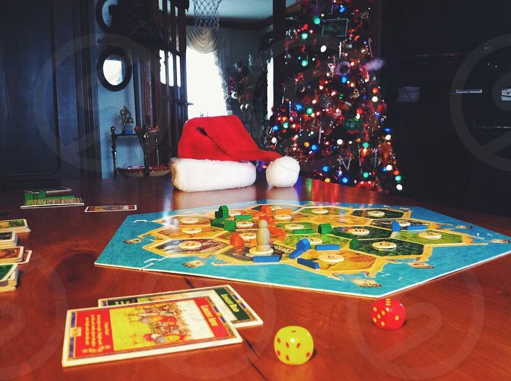 Christmas Santa Hat Tree Family Games Settlers of Catan Fun photo
