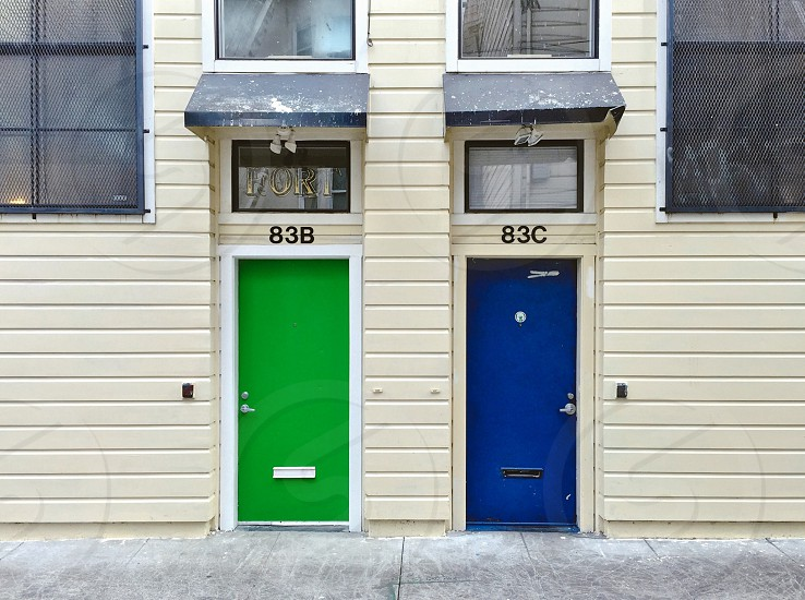 Green door and blue door with awnings photo