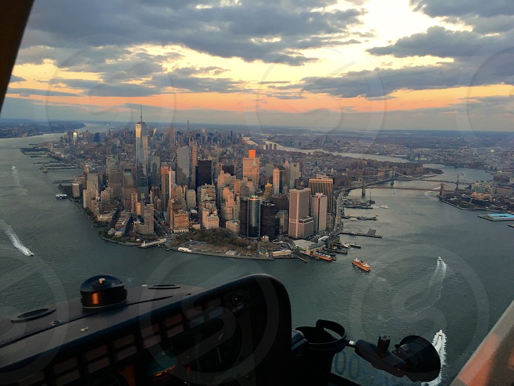New York Manhattan One world Trade center skyscraper island cityscape helicopter control panel architecture aerial sunset Hudson river photo