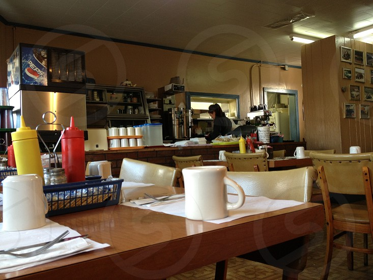 Mostly empty diner with coffee cup photo