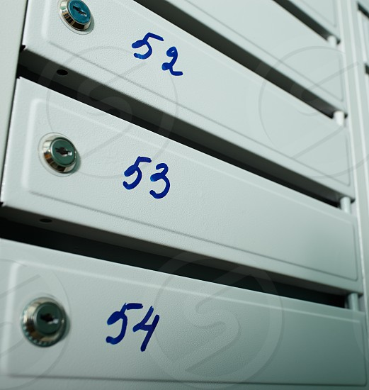 Gray blue metallic mailboxes with flat numbers. photo