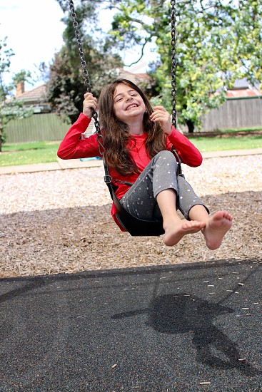 Child happy swinging  photo