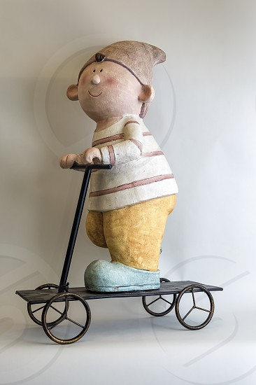 Gnome riding a scooter photo