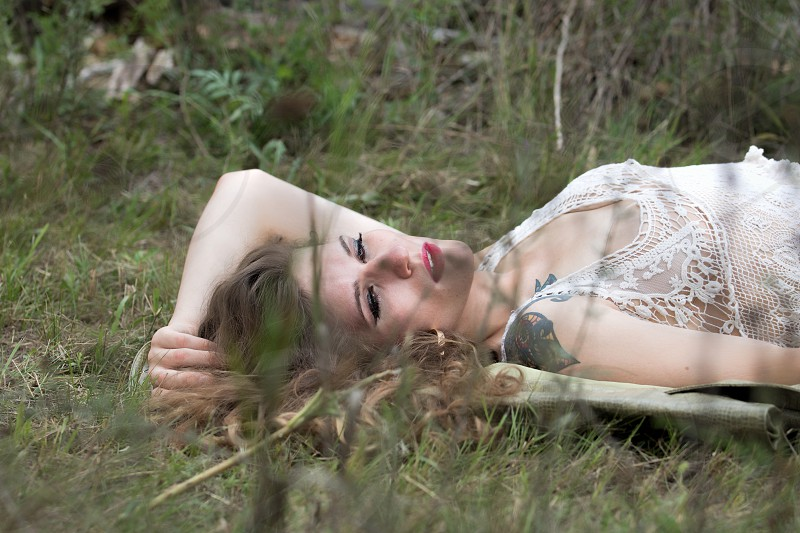 A woman daydreaming in a field.  Release available upon request. photo