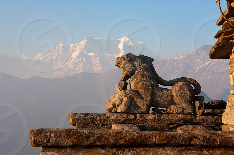 Stone Snow Lion - a sacred Hindu place in the Indian Himalayas - Tungnath India Travel photo