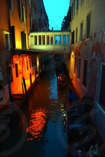 people on boat at venice canal photo