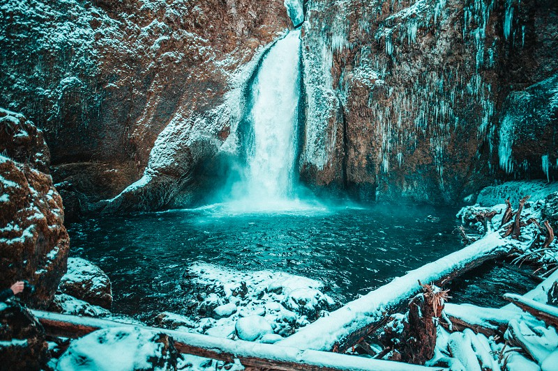 A beautiful view of an Oregon waterfall in the wintertime. photo