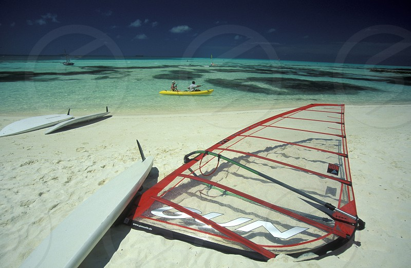 surfing on a beach with the seascape of the island and atoll of the Maldives Islands in the indian ocean. photo