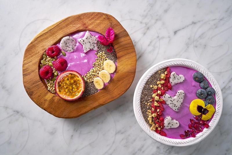 Acai bowls smoothie with passion fruit pitaya banana and berries photo