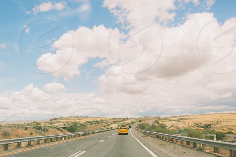 A view of puffy clouds from the road in Arizona. photo