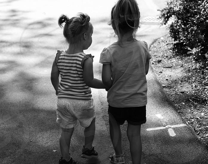 Cousins holding hands photo