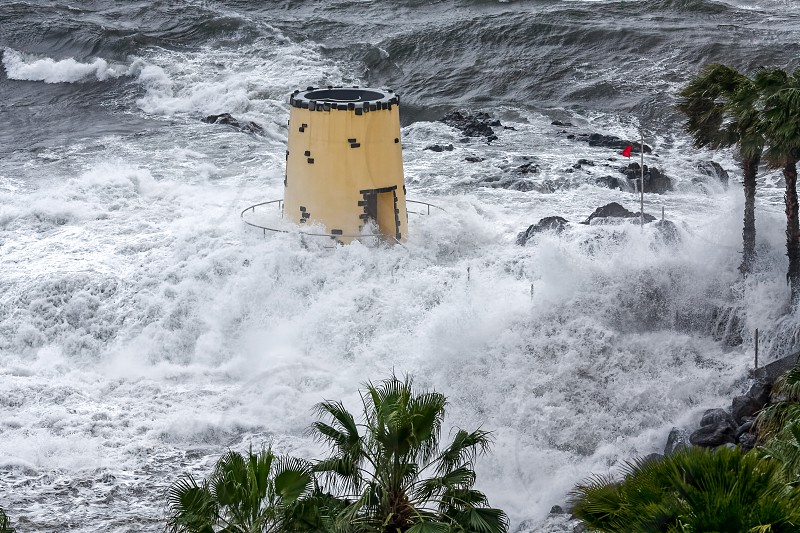 FUNCHAL MADEIRA/PORTUGAL - APRIL 9 : Tropical storm hitting the lookout tower in the grounds of the Savoy Hotel Funchal Madeira on April 9 2008 photo