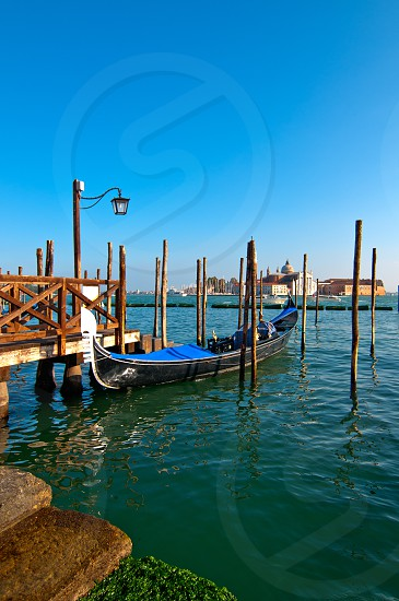 Venice Italy pittoresque view of gondolas  with Saint George island on background photo