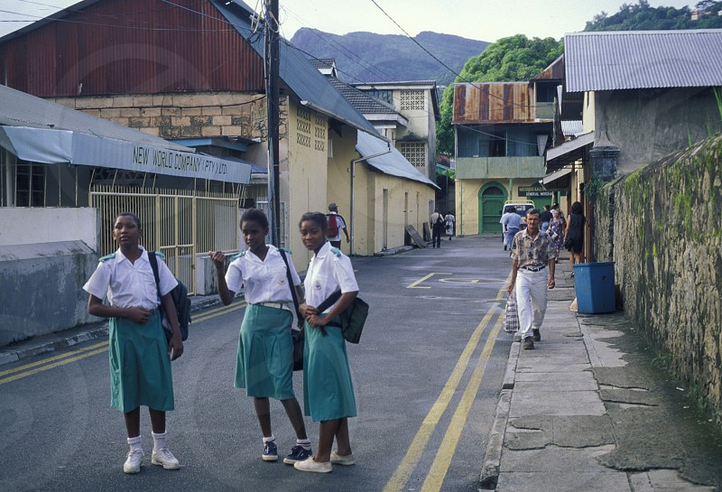 school childern in the city of Victoriaon the Island Mahe of the seychelles islands in the indian ocean photo