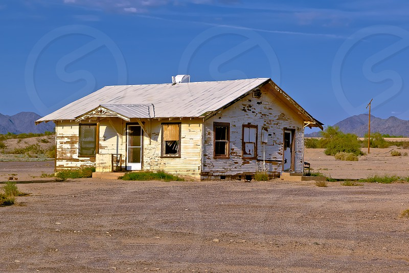 An abandoned house in a remote area near Gila bend Arizona. I remember this home being occupied many years ago before the Great Recession. It burned down in 2014. photo