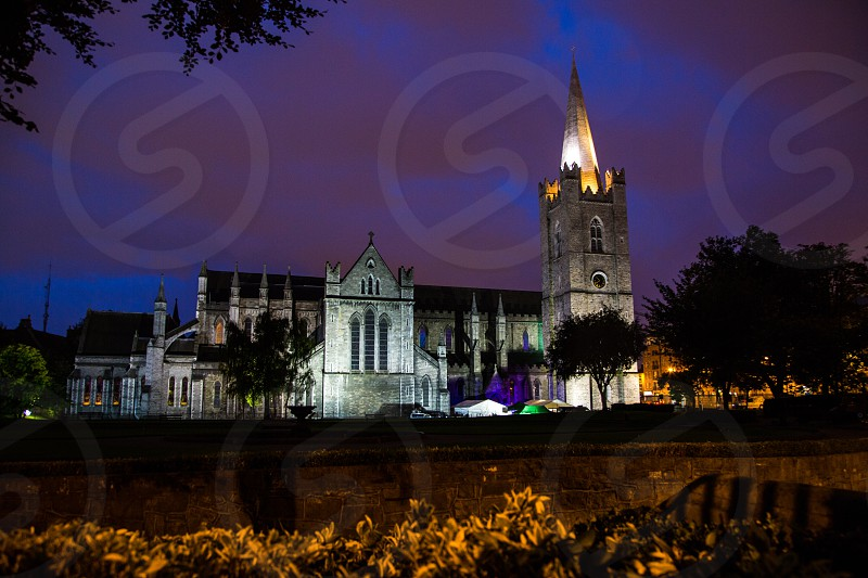 This is a photo of the side of St Patrick's Cathedral in Dublin Ireland at night. This is a long exposure shot taken during an event that was going on outside. photo
