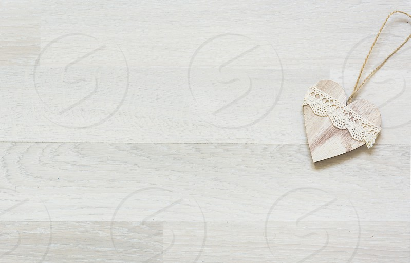 wooden decorated hearts on white background photo