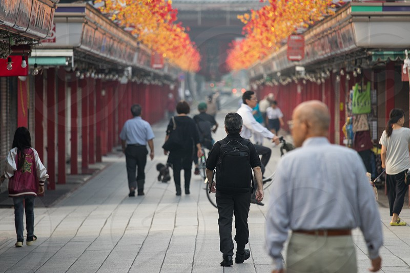 Streets of Tokyo - almost empty path to Asakusa shrine in early morning hours photo